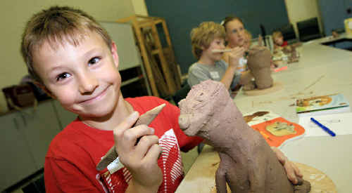 Purr-fect: Angus Mcfarlane, 8, works on his clay cat at the Tweed River Regional Art Gallery holiday workshop.