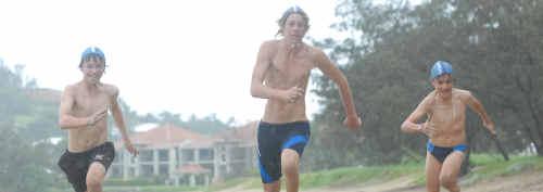 Eimeo Surf Life Saving Club's Jack Macdonald, Dylan Burnett and Will Lansbury practise.