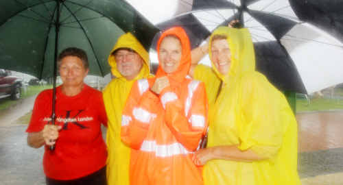 Despite the continuous torrential rain, holiday makers at Cotton Tree Caravan Park, Julie Germain, Dennis Galvin, Kylie Short and Julie Galvin, still found reason to stay cheerful.
