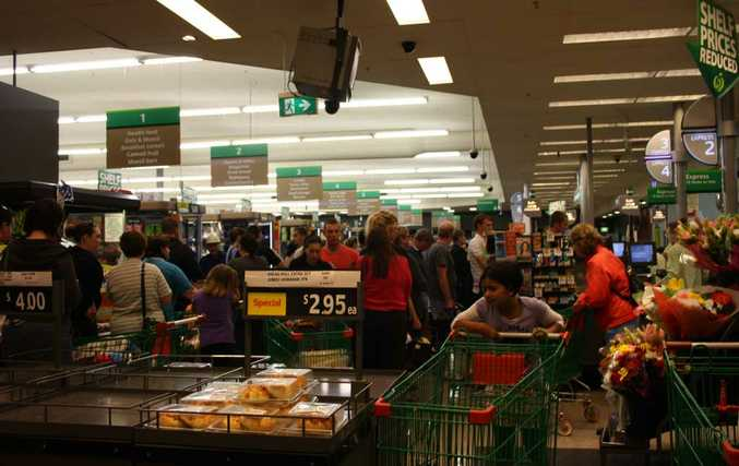 People crowd Wilsonton Woolworths as they stock up for the big wet.