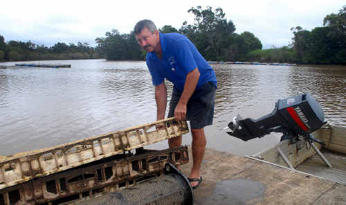 Urunga oyster grower John Lindsay was glad to find his oyster leases stood up to the floodwaters.