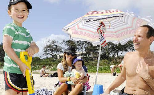 Levi Smorgon, 4, made the most of yesterday's sunshine at Main Beach Byron Bay, along with his parents, Melanie and Dale, and brother Harper, 2.