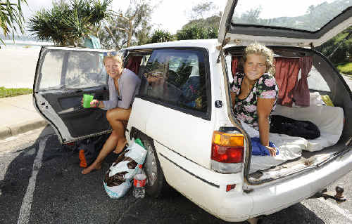 Backpackers Sophie Bruhn and Gesa Boesch have been sleeping in their station wagon in Byron Bay saying they can't afford to pay camping fees.