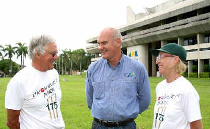 Norths Cricket Club's Graeme Dunk, centre, shows English visitors Gordon and Lorraine Pells some of Mackay's landmarks.