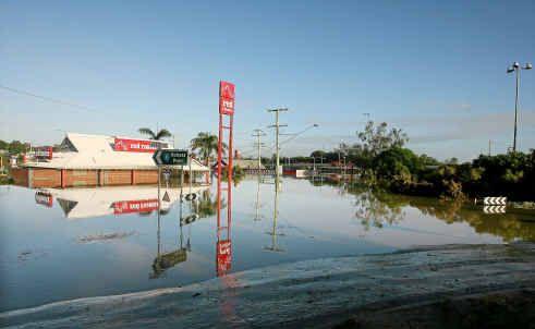 Receding flood water at Goodna on Thursday.