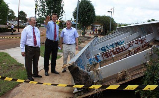 Cr Noel Strohfeld, Mayor Peter Taylor and Federal Member for Groom Ian Macfarlane inspect the flood damage in Toowoomba.