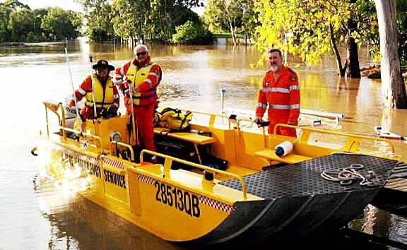 SES volunteers Mary Stark from Sarina, Bob Gould from Mackay and Whitsunday SES controller Mark Connors at the Yeppen flood plain in Rockhampton on Tuesday.