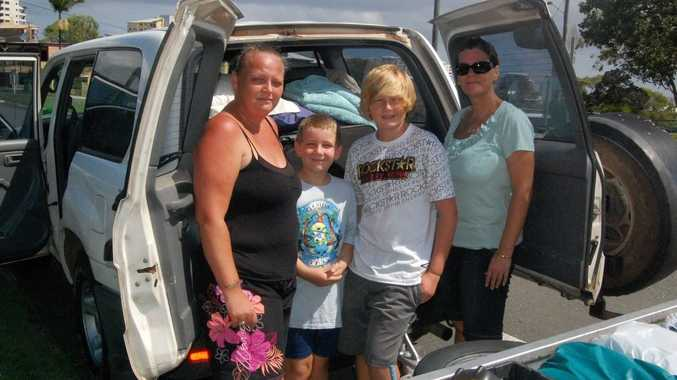 Mum Kylie Taylor, sons Brayden and Cody Hunter and the boy's grandma Helen Blaine prepare to go and help their great grandma Thora Turner in flood ravaged Ipswich.