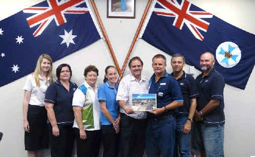The seven staff who assisted in the Disaster Co-ordination Centre at Emerald, Brendan Ryan, John Zimmermann, Kirsty Ryan, Fiona Chambers, Jo-Anne Dougan, Linda Mackenzie and Bruce Chester-Master, discuss the effort with Central Highlands Mayor Peter Maguire, centre.