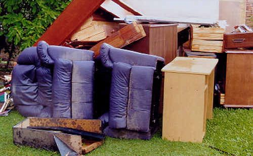 Some of the furniture owned by Dealia Walsh and her parents, Bruce and Mavis Ellis, which was ruined when floodwater inundated their house during Mackay's 2008 floods.