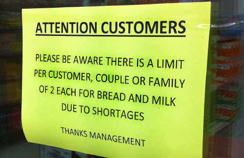 RATIONAL BEHAVIOUR WANTED: Shop owners take matters into their own hands to stop residents panic-buying amid fears of being cut off from food supplies. cont