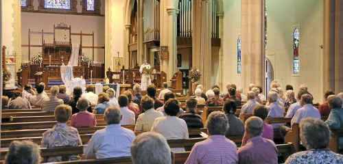 Anglican Bishop of Toowoomba and the South West Region Rob Nolan leads an ecumenical service for flood victims at St Luke's Church in Toowoomba yesterday.
