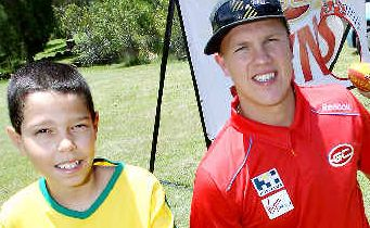 Rising suns: Nathan Ablett and Zac Smith share ball-skills with Miguel, 10, and Rafael, seven.