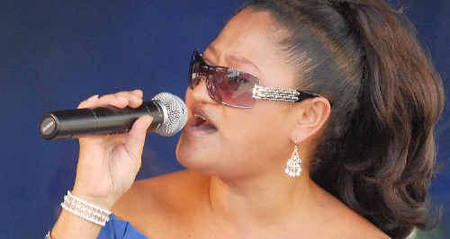 Mango Junction singer Jo-anne Zemlicott kicks off yesterday's Flood Relief Appeal Concert.