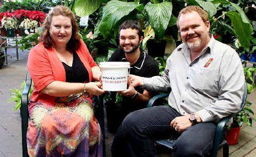 Sandy McNamara, left, Gavan Porter and Greg Porter have been busy raising funds for Queensland's flood victims.