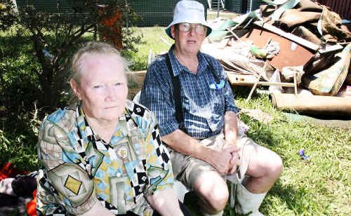 April and Albert Jessen try to salvage personal belongings in the rubble that was their West Ipswich home.