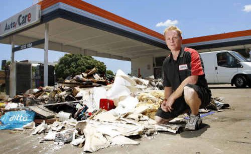 Autocare Ipswich manager Richard Peasey has started work rebuilding his business after it was inundated by flood waters.