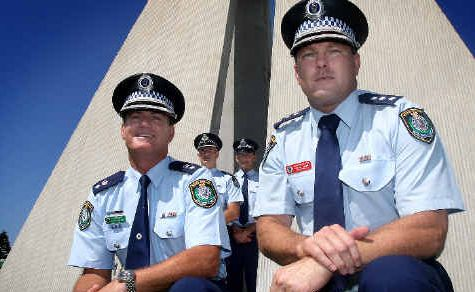 Police united: Tweed Heads Local Area Commander Supt Stuart Wilkins and Det Insp Shane Diehm with (rear, from left) Gold Coast District officers Chris Ahearn and Supt Paul Ziebarth.