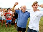 D-Day: Eddie Rounds and Richard Gow, with Hastings Point residents, celebrate the council's decision.