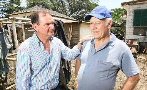 Ipswich Mayor Paul Pisasale consoles Ian Surawski at his wrecked home in Brisbane Terrace, Goodna, following last week's devastating floods.