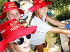 Surf lifesavers Julia O'Brien, Erica Ricketts and Ines Kharoumi clean up in North Booval.