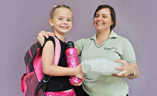 Lorelle Rickard helps prepare her daughter, Sienna, for her first day at North Arm State School.