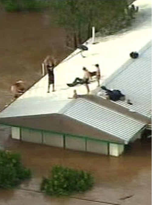 Residents clambered onto roofs to escape the inland tsunami.