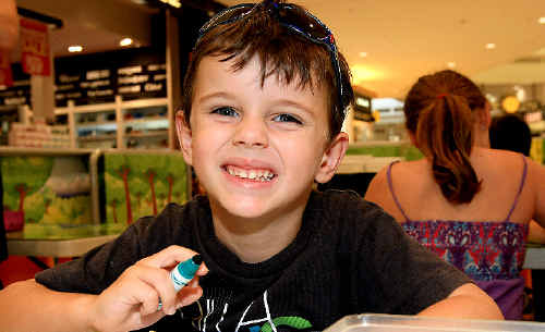 Four-year-old Wade Smith enjoys Tweed City Shopping Centre's craft village.