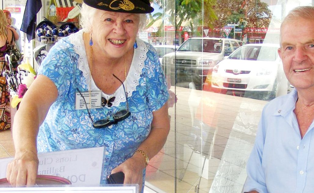 HAPPY TO HELP: Margaret McDonald drops some money into the Ballina Lions flood appeal bucket last week, manned by club president Des Emmett.