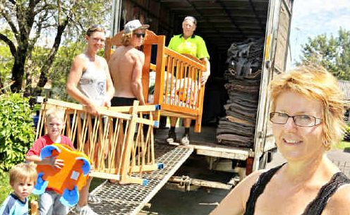 Jan Murray and her helpers load baby goods on to a truck bound for Bundamba to help out flood victims.