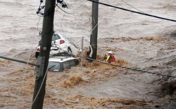 A swift water rescue technician struggles to save two women caught in a deadly torrent.