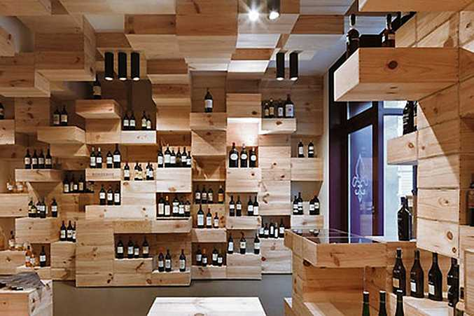 Wooden wine crates serve as everything from furniture and chairs, to platforms for showcasing bottles and books at The Albert Reichmuth Wine Store in Zurich.