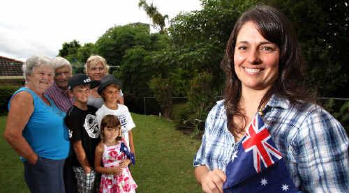 I am Australian: Tammi Elsner celebrates becoming an Australian citizen with family members, from left in background, Lottie Elsner, Katie Elsner, Edmund Elsner, Kaleb Graham, Anita Graham and Nathan Elsner.