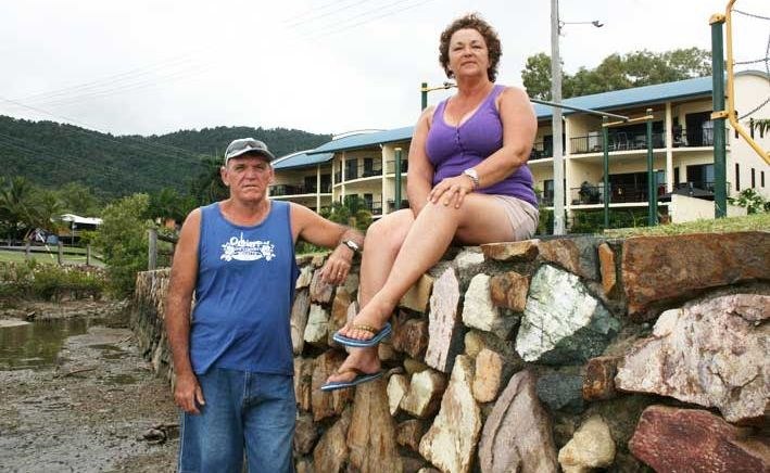 Concerned Coral Esplanade residents Mark Nicol and Ollie Humpry at the Cannonvale Foreshore playground sea wall which they believe is unsafe.