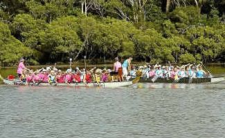 Flood paddlers: The Titivators and Coffs Harbour dragon boat clubs paddling for flood victims on the Kalang River.
