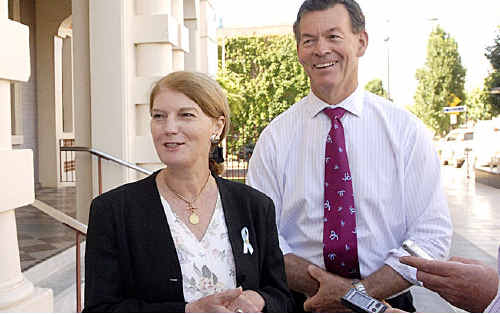 Queensland Governor Penelope Wensley meets with mayor Peter Taylor outside City Hall.