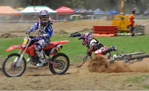 World of pain: The spills and stacks at the Coffs Harbour Stadium Motocross were as spectacular as some of the close race finishes.