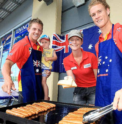 Keep safe: Daniel Harris, Sam Harris, 3, Zoe Burgh and Brandon Matera fire up an Australia Day barbie.