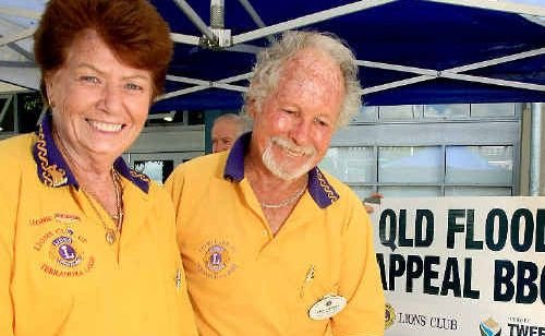 Helping out at the barbecue are Leonie Daley and Stan Felsman.