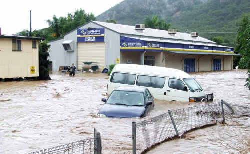 The flood waters surge through the streets of Esk.
