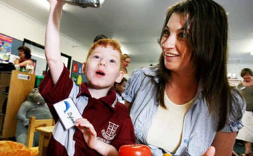 Dylan Stone with his mum Paula at his first day of school at Ipswich Grammar School and (below) Dylan when he was five days old.
