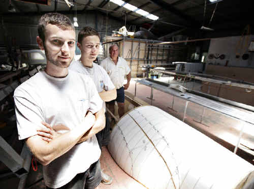 Ballina aircraft builder Howard Hughes (rear), of Australian LightWing, with French Air Force Academy students Benjamin Gans (front) and Fabien Moffat, who have been helping design and build the revolutionary LightWing SP-6000.