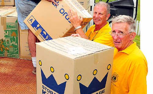 Peregian Beach, Noosa Heads and Tewantin Noosa Lions Club members load flood relief donations.