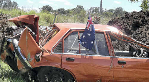 Australian flags are flying across the flood-ravaged town of Grantham as the community prepares to celebrate Australia Day.