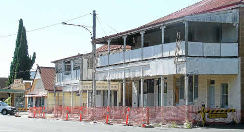 Details of safety work needed on the Plumb's Chambers buildings are scant. The older building (at left) may be the oldest shop in Queensland, according to Canning Downs stud owner John Barnes.