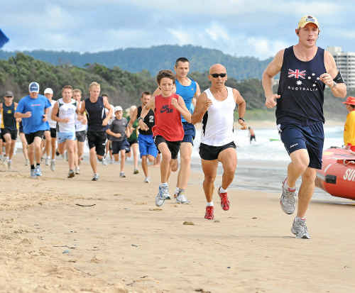Runners head back to the surf clubhouse in the early stages of the 2010 Australia Day Fun Run.