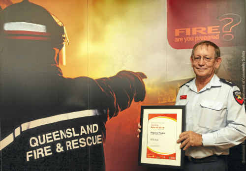 Station officer Trevor Kidd is rewarded with a Training Award at the Central Region Australia Day Awards on his last day of service.