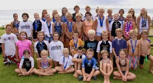 Talented line-up: Sawtell's happy band of competitors had plenty to smile about at the Country surf championships.