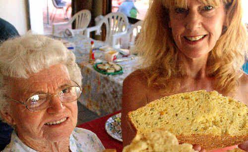 Dot Lange and Louise Adele with some fresh damper at Uki's Australia Day celebrations.