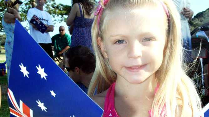 Pictured waving her flags at Brunswick Heads is four-year-old Misty Fahy.